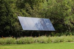 Solar panel in front of trees Royalty Free Stock Photo