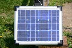 Solar panel in garden front view. Small solar panel installed on garden fence, front view Royalty Free Stock Photo