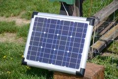 Solar panel in garden side view. Small solar panel installed on garden fence, side view Stock Image