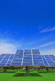 Solar Panel with grass and blue sky Stock Photo