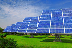 Solar Panel with green grass and beautiful blue sk Stock Photo