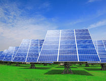 Solar Panel with green grass and blue sky Royalty Free Stock Photo