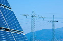 Solar Panel and High Voltage Tower Royalty Free Stock Photo