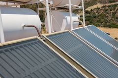 Solar panel hot water system. On the roof royalty free stock images