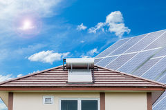 Solar panel for hot water system on roof blue sky background , E. Nergy saving and natural energy concept Royalty Free Stock Image