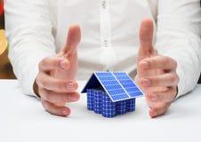 Solar panel house between a hands. Digital composite of solar panel house between a hands Stock Photography