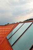 Solar panel on the house roof. Solar panel (geliosystem) on the house roof Royalty Free Stock Images