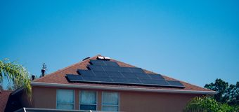 Solar panel on a house roof royalty free stock photography