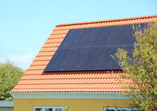Solar panel on House Roof with Red Tiles Stock Photography