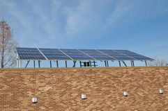 Solar panel installation. Image of solar panels installed on a comercial building Stock Image