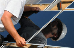 Solar Panel Installation. Installation of Solar Panels on New Solar Farm in California Royalty Free Stock Photos
