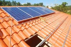 Solar panel installation. Installation in progress of solar panels on roof Royalty Free Stock Images