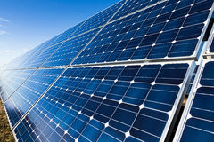 Solar panel installation. Solar panel with sun reflection and blue sky Stock Photography