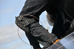 Solar Panel Installer. On Residential Roof Stock Photos