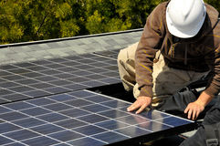 Solar Panel Installer 2. Solar Panel Installer on Residential Roof Stock Images