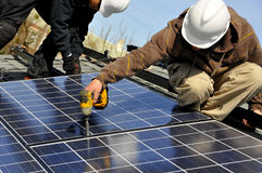 Solar Panel Installers 2. Installing Photovoltaic Solar Panels on Residential Roof Royalty Free Stock Photo
