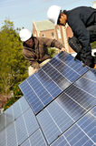 Solar Panel Installers 3. Installing Photovoltaic Solar Panels on Residential Roof Stock Images