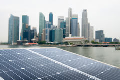 Solar panel and modern city Stock Image
