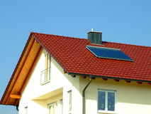 Solar Panel Modern Home. The roof of a modern home - with a solar panel, and a few windows visible under it Stock Photos