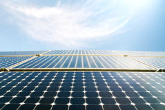 Solar panel modules in the sun. Solar panels against a blue sky characterized by a strong sunlight royalty free stock photos