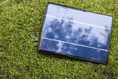 Solar panel on the moss. One solar panel on the green moss Royalty Free Stock Photo