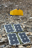 Solar Panel on Mountain Landscape for Generating Power for Expedition. Solar Battery on Rocky Glacier Moraine for Electricity Supply of Sport Mountain Expedition royalty free stock images