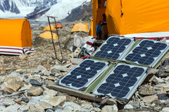 Solar Panel on Mountain Landscape for Generating Power for Expedition. Solar Battery on Rocky Glacier Moraine for Electricity Supply of Sport Mountain Expedition stock photo