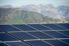 Solar panel with mountains on sunny day. Green economy efficient energy safety for environmental concept.  stock photo
