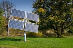 Solar panel in nature with green vegetation Stock Photo