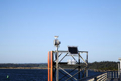 Solar Panel Navigational Aid Dock Seagull Blue Sky Stock Photos