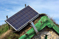 Solar panel on old cabin roof Stock Photo