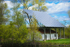 Solar Panel. A solar panel over a shed at the Barkhausen Wildfowl Preserve in Suamico, Wisconsin Royalty Free Stock Image