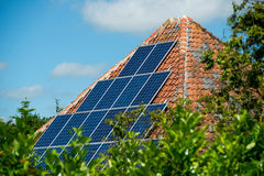 Solar panel. S on a old roof of a barn in Holland Stock Image