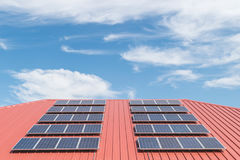 Solar panel pattern on red roof tile. Solar power Royalty Free Stock Images
