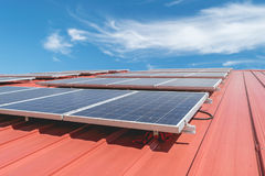 Solar panel pattern on red roof tile. Solar power Royalty Free Stock Image