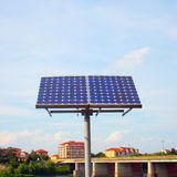 Solar panel. In plain air, with town on the background Stock Images