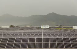 Solar panel power station on cloudy day Stock Photography