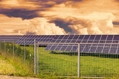Solar panel produces green, environmentally friendly energy from the sun.Sunset sky. Stock Image