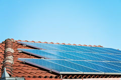 Solar Panel On A Red Roof Stock Photo