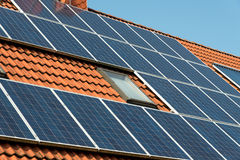 Solar panel on a red roof. Renewable alternative energy source Stock Photo