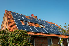 Solar panel on a red roof. Renewable alternative energy source Stock Photos