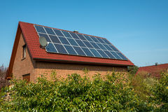 Solar panel on a red roof. Renewable alternative energy source Royalty Free Stock Photo