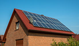 Solar panel on a red roof. Renewable alternative energy source Royalty Free Stock Images