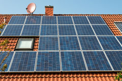 Solar panel on a red roof. Renewable alternative energy source Stock Image