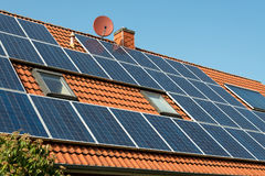 Solar panel on a red roof. Renewable alternative energy source Royalty Free Stock Photos