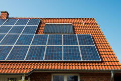 Solar panel on a red roof. Renewable alternative energy source Stock Photography