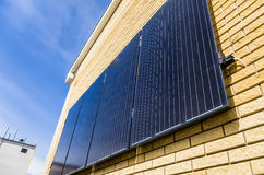 Solar panel reflecting sun and blue sky Royalty Free Stock Photo
