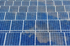 Solar panel with reflection blue sky royalty free stock photo