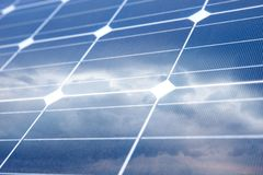 Solar Panel with reflection of sky and white clouds Stock Images