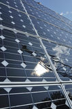 Solar Panel with Reflection of Wind Turbine Royalty Free Stock Photography